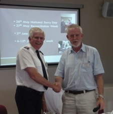 Former QCT President Lieut Colonel Ray Wilson handing over presidency to Rev Stephen Nuske. Photo by QCT.