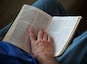 Bruce Boling, holds a Bible open while participating in a Bible study group in Gallatin, Tenn., Sunday, April 1, 2012. RNS photo by Jeff Adkins/USA Today. 