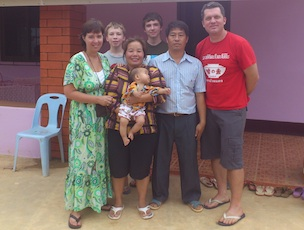 The Sergeants and the orphanage parents, Mon and Surasak. Photo by QCT.